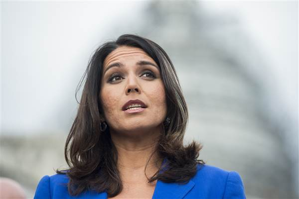 Rep. Tulsi Gabbard, D-Hawaii, speaks at a news conference on the Trans-Pacific Partnership outside of the U.S. Capitol on Nov. 18, 2015. Bill Clark / CQ Roll Call via AP