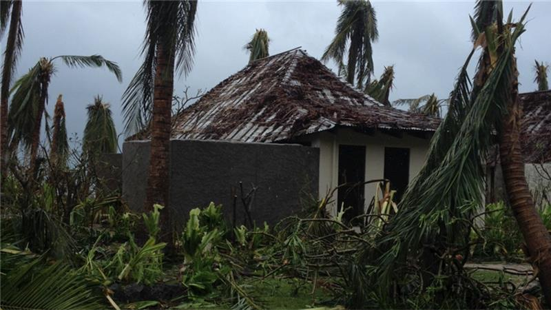 A beachside villa and trees lay destroyed following high winds caused by Cyclone Winston [Sarah Bingham/Reuters]