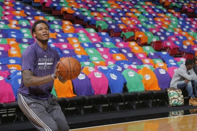Sacramento Kings' shooting guard Ben McLemore poses with Kings shirts in Hindi