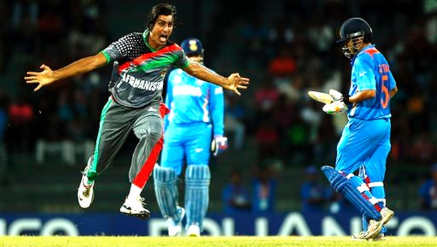 Afghanistan's bowler Shapoor Zadran, left, reacts after taking the wicket of Gautam Gambhir, right, during their ICC Twenty20 Cricket World Cup match in Colombo, Sri Lanka, Wednesday. India beat Afghanistan by 23 runs. AP