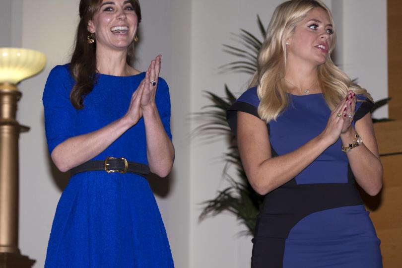 "Catherine, Duchess of Cambridge (L) and TV presenter Holly Willoughby attend The Fostering Network's annual ""Fostering Excellence Award"" to celebrate the achievements of foster carers, young people, social workers, and others within the fostering community in London, November 17, 2015."