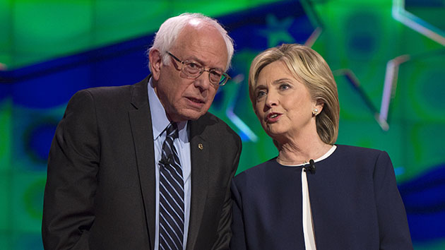Oct.13, 2015 - Las Vegas, Nevada, U.S. - BERNIE SANDERS and HILLARY CLINTON chat during the photo spray at the first Democratic Presidential Debate of the 2016 campaign. Five Democratic contenders will take the debate stage for the first time Tuesday evening.(Credit Image: © Brian Cahn via ZUMA Wire)