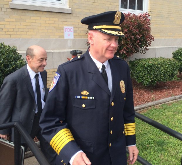 Madison police chief Larry Muncey leaves federal court on Friday, followed by his attorney, Jerry Barclay.
