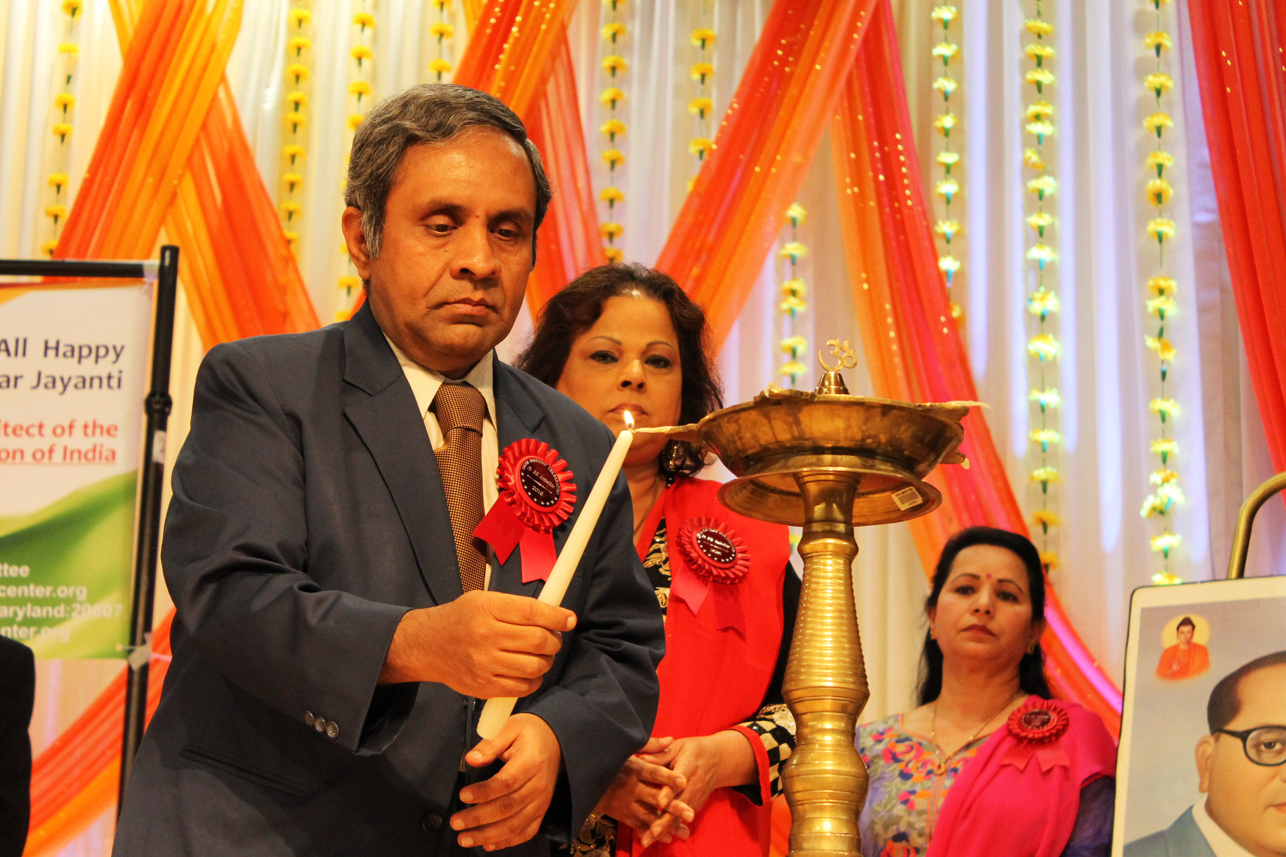 Consul General of India in San Francisco, Ambassador Ashok Venkatesan lights the ceremonial 'Diya'