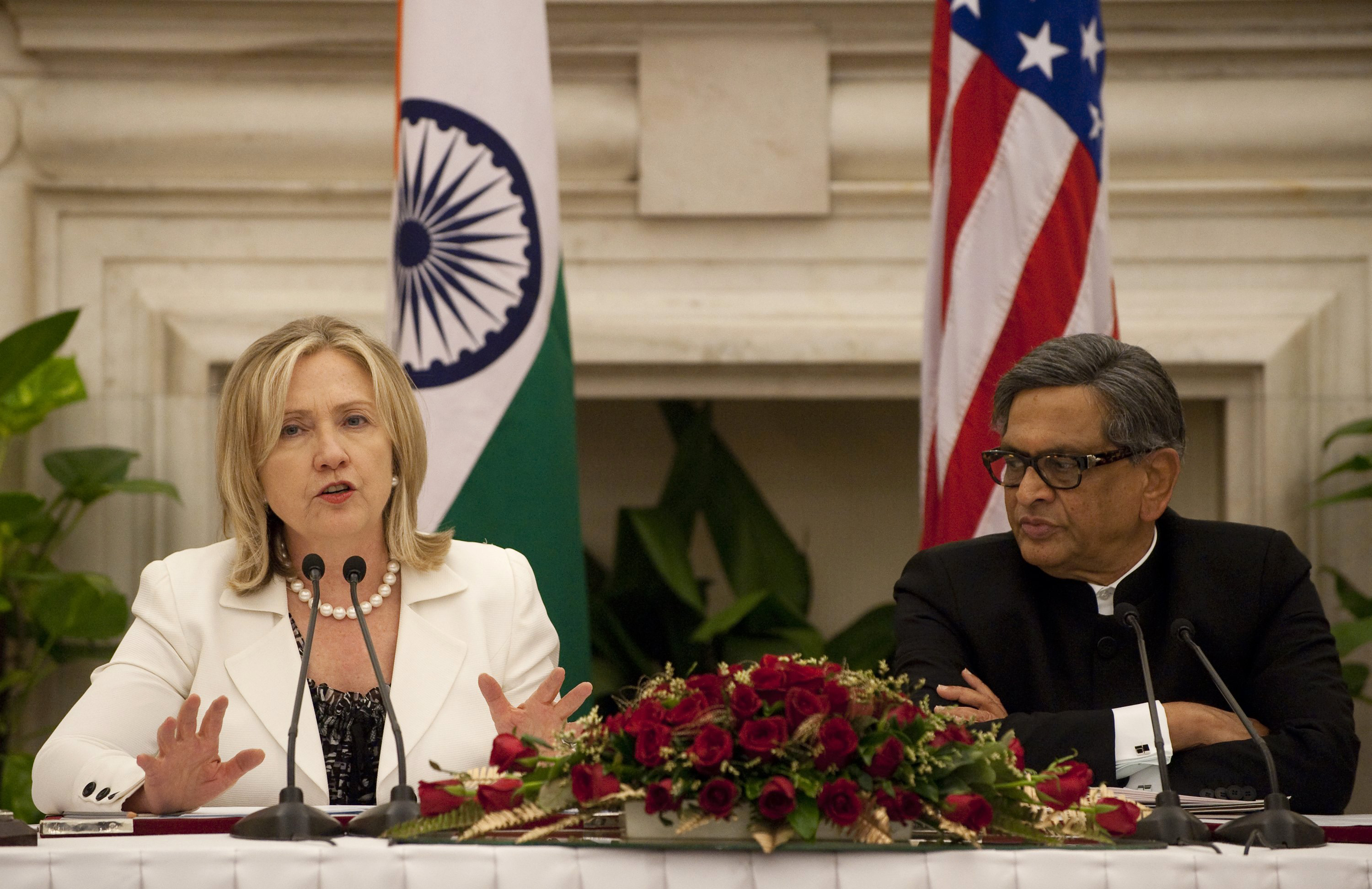 "US Secretary of State Hillary Clinton and Indian Foreign Minister S.M. Krishna hold a joint press conference during the US-India Strategic Dialogue at Hyderabad House in New Delhi on July 19, 2011. US Secretary of State Hillary Clinton called for deeper regional security cooperation and trade ties in talks with Indian leaders, held in the shadow of triple bomb blasts in Mumbai. India's concerns over the US troop drawdown in Afghanistan and New Delhi's renewed peace talks with arch-rival Pakistan are expected to figure in the ""strategic dialogue"" underway in the Indian capital. AFP PHOTO / POOL / Saul LOEB (Photo credit should read SAUL LOEB/AFP/Getty Images)"