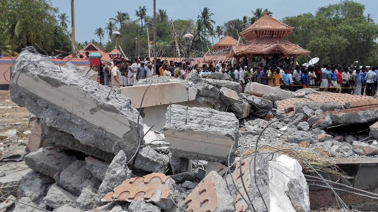 A view of a collapsed building after a massive fire broke out during a fireworks display at the Puttingal temple complex in Paravoor village, north of Thiruvananthapuram, India, on April 10, 2016.