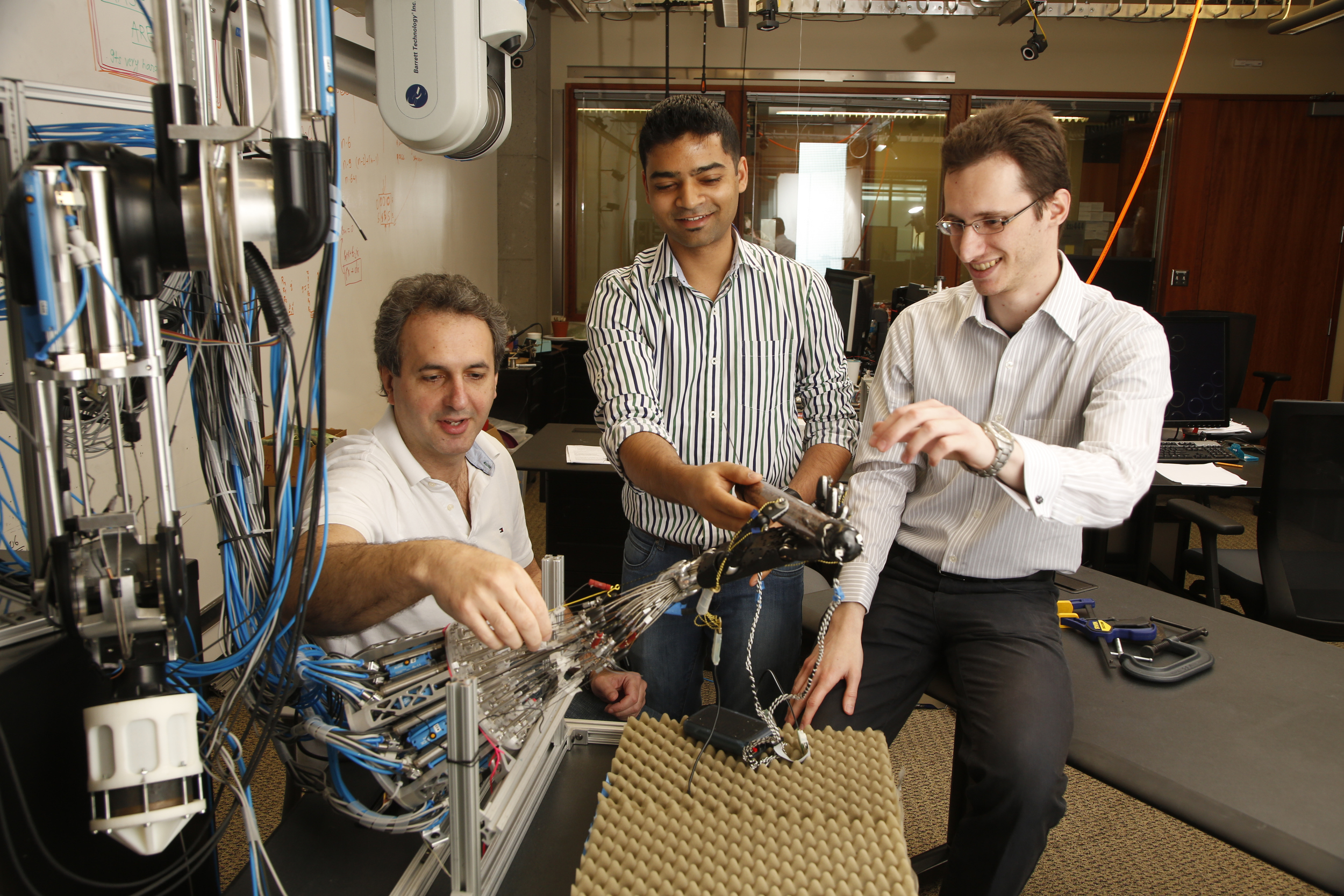 The research team from the UW Movement Control Laboratory includes (left to right) Emo Todorov, associate professor of computer science and engineering and of applied mathematics; Vikash Kumar, doctoral student in computer science and engineering; and Sergey Levine, assistant professor of computer science and engineering.University of Washington