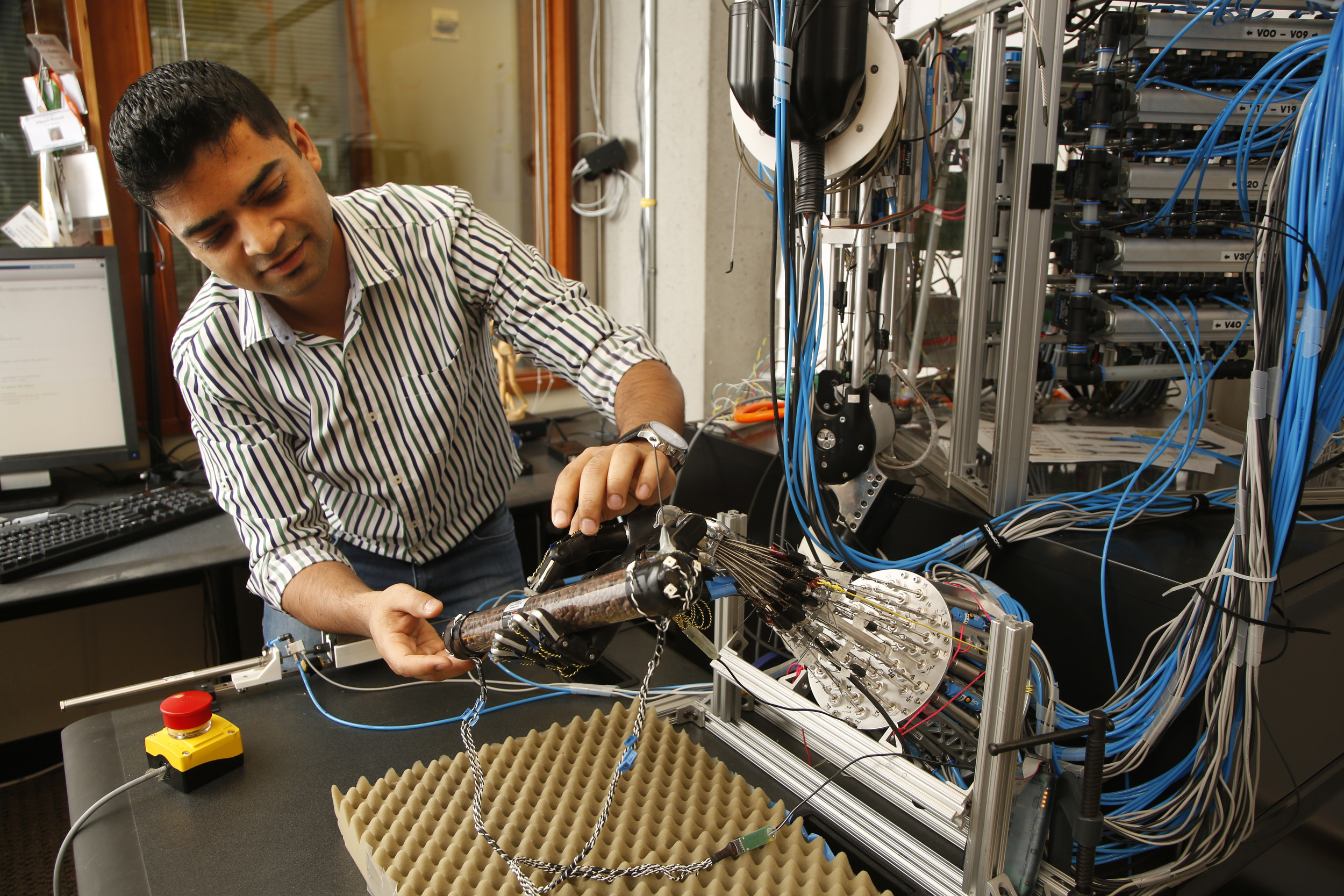 UW computer science and engineering doctoral student Vikash Kumar custom built this robot hand, which has 40 tendons, 24 joints and more than 130 sensors. University of Washington