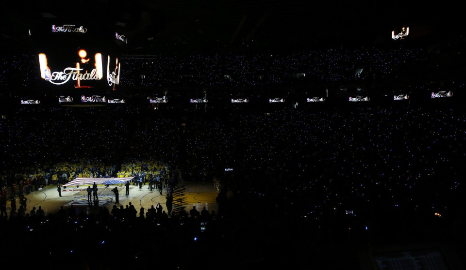 The flag is unfurled before the national anthem at Oracle Arena. May 27, 2016. (Gus Chan / The Plain Dealer)