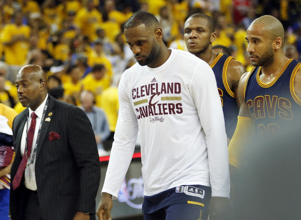 Cleveland Cavaliers forward LeBron James walks off the court after the Cavaliers were blown out 110-77 by the Golden State Warriors. June 5, 2016.