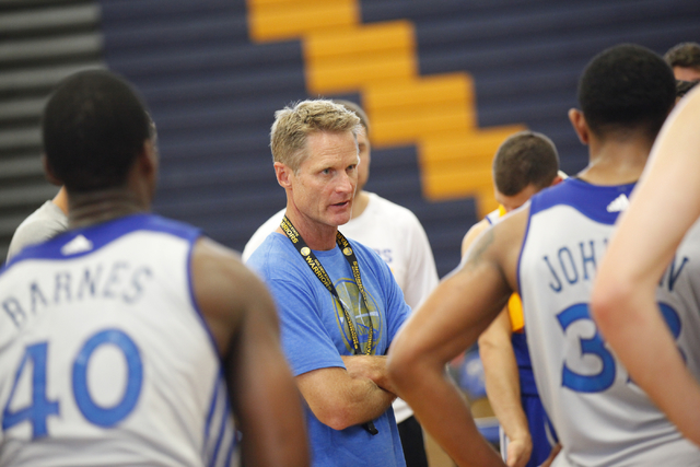 Head coach Steve Kerr with players during practice.