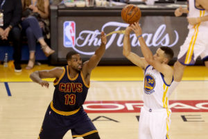 OAKLAND, CA - JUNE 05: Tristan Thompson #13 of the Cleveland Cavaliers contests a shot by Stephen Curry #30 of the Golden State Warriors in Game 2 of the 2016 NBA Finals at ORACLE Arena on June 5, 2016 in Oakland, California. (Photo by Ezra Shaw/Getty Images)