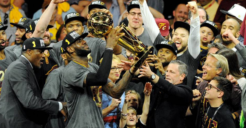 LeBron James, majority owner Dan Gilbert and the rest of the Cleveland Cavaliers celebrate Sunday after winning the NBA title. PHOTO: GARY A. VASQUEZ/REUTERS