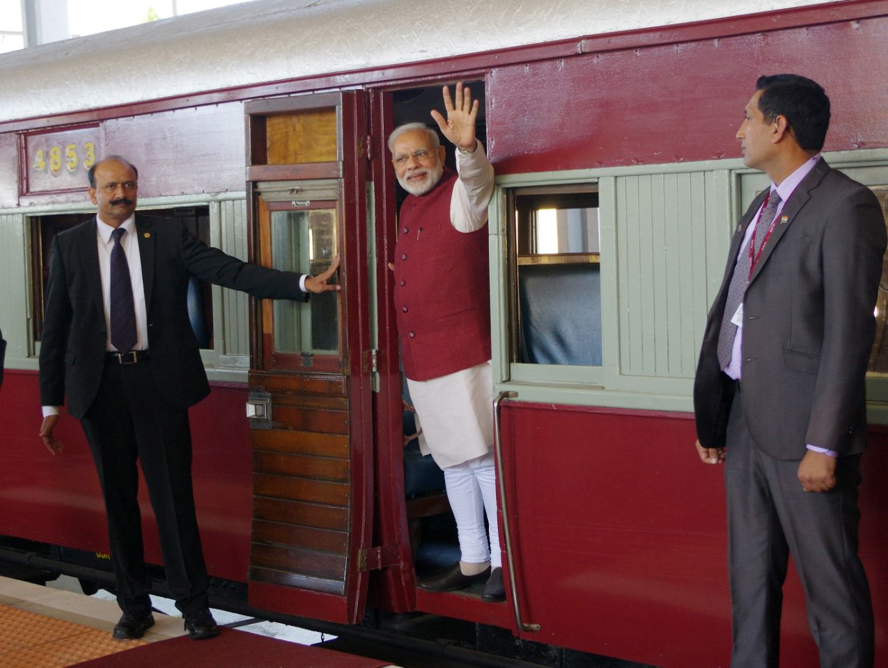 Indian Prime Minister Narendra Modi, waves from a train carriage at Pentrich Railway station in Pietermaritzburg, South Africa, Saturday July 9, 2016. Narendra Modi is taking the same historic train trip that Mahatma Gandhi took in 1893 when he was thrown off the train because of his race. Modi is on a four nation trip to Africa.