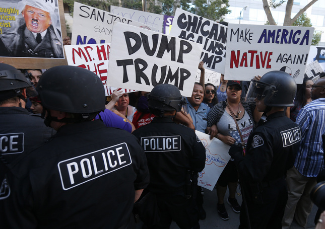 Protesters gather outside San Jose Convention Center as presidential candidate Donald Trump holds a rally in San Jose on Thursday, June 2, 2016.