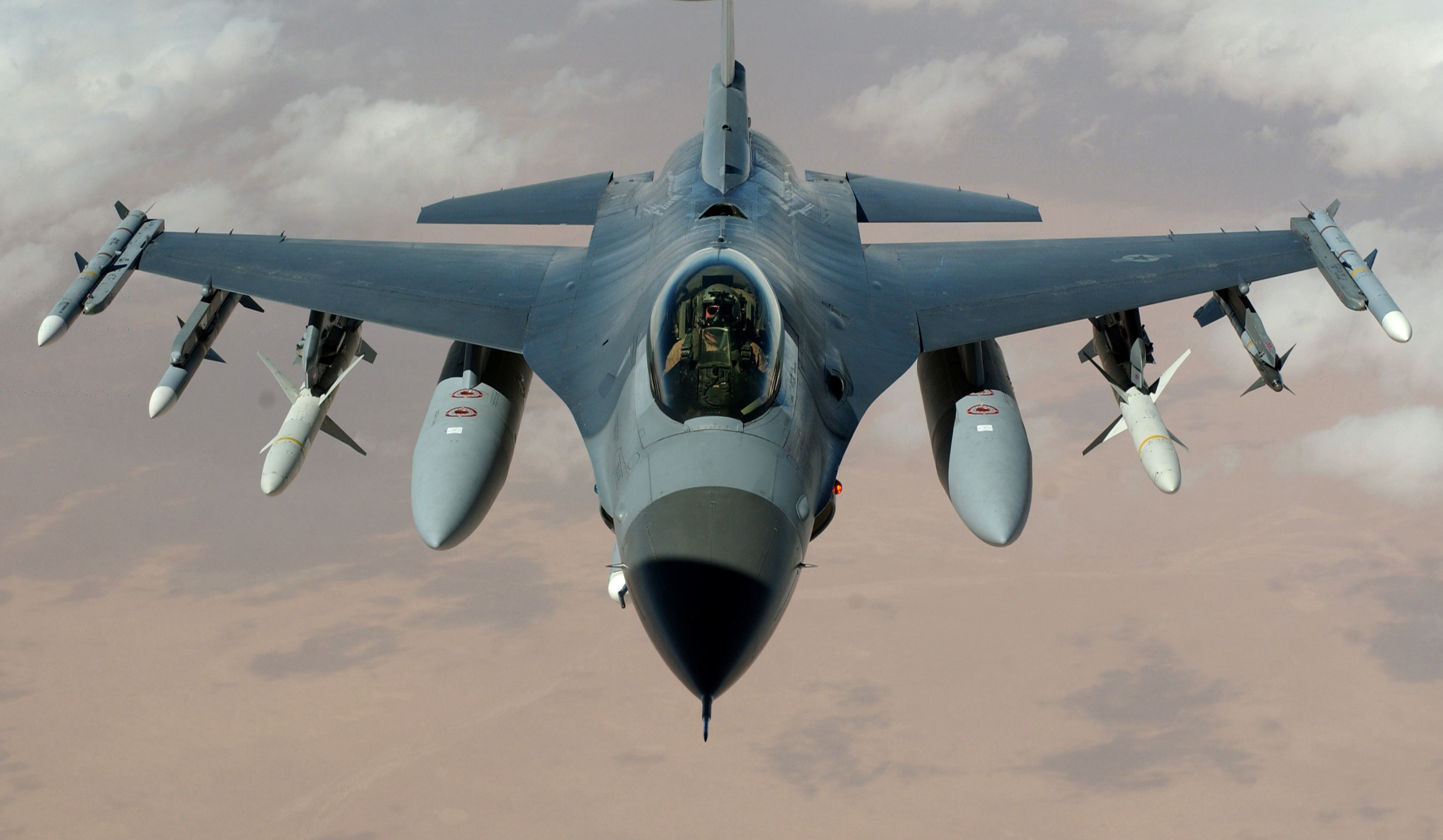 """OPERATION IRAQI FREEDOM -- An F-16 Fighting Falcon flies a mission in the skies near Iraq on March 22. The F-16s are from the 35th Fighter Wing """"Wild Weasels"""", Misawa Air Base, Japan."""