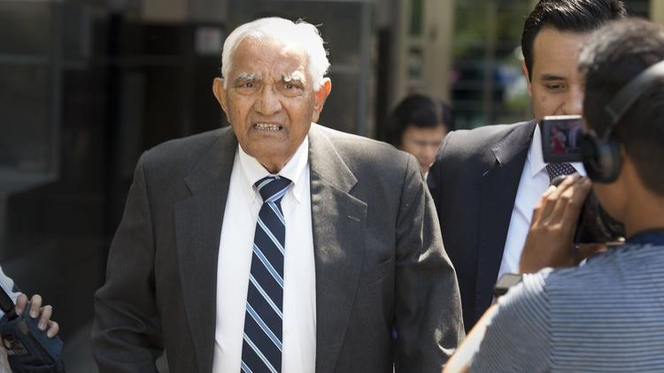Babulal Bera, the father of Rep. Ami Bera (D-Elk Grove), leaves the federal courthouse with attorney Edward Loya Jr., right, on May 10 in Sacramento.