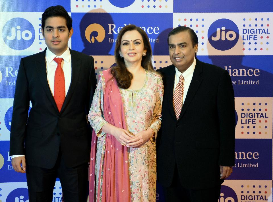 Reliance Industries chairman, Mukesh Ambani with wife Nita and son Akash at the company's annual general meeting