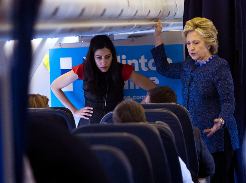 Huma Abedin and Hillary Clinton on the campaign's plane on Friday.