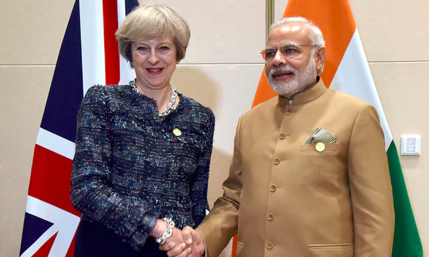 Prime Ministers Theresa May and Narendra Modi.