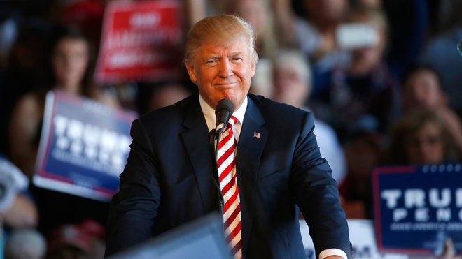 Republican presidential candidate Donald Trump approaches the podium to speak at a rally on October 18, 2016 in Grand Junction Colorado. Trump is on his way to Las Vegas for the third and final presidential debate against Democratic rival Hillary Clinton. (Photo by George Frey/Getty Images)