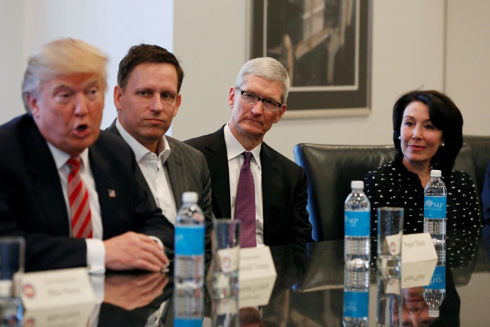 U.S. President-elect Donald Trump speaks as (2nd L to R) PayPal co-founder and Facebook board member Peter Thiel, Apple Inc CEO Tim Cook and Oracle CEO Safra Catz look on during a meeting with technology leaders at Trump Tower in New York U.S., December 14, 2016. REUTERS/Shannon Stapleton - RTX2V24O
