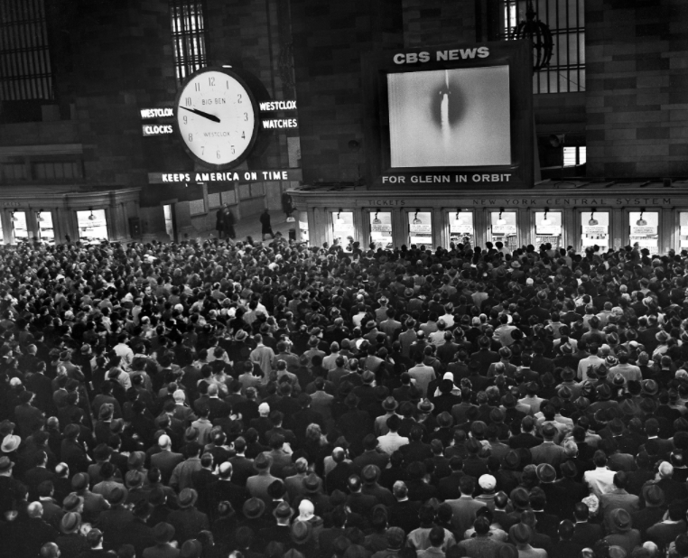 Commuters filled the concourse of Grand Central Terminal to watch as Glenn became the first American to orbit Earth.