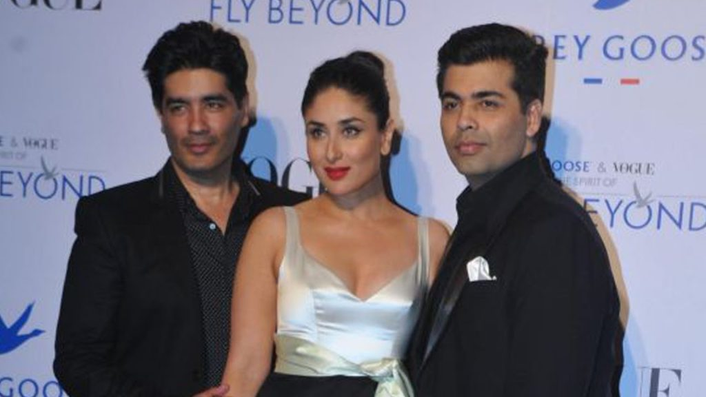 Manish Malhotra to the left, Kareena Kapoor Khan and Karan Johar at an event