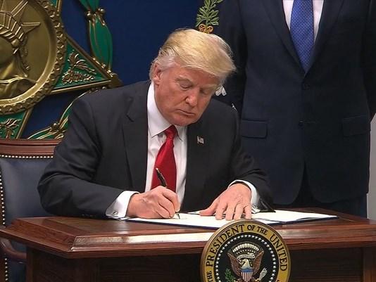 President Donald Trump signing Executive Orders