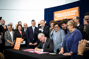 Gov. Phil Murphy signing several gun-safety bills into law in Trenton yesterday. Photo: Edwin J. Torres/Governor's Office