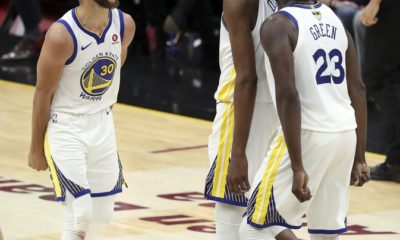 Golden State Warriors' Kevin Durant celebrates with Stephen Curry, left, and Draymond Green (23) during the second half of Game 3 of basketball's NBA Finals against the Cleveland Cavaliers, Wednesday, June 6, 2018, in Cleveland. The Warriors defeated the Cavaliers 110-102 to take a 3-0 lead in the series. (AP Photo/Carlos Osorio)