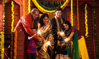 Indian Family celebrating Diwali festival with sparklers