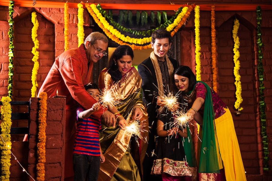 Indian Family celebrating Diwali festival with sparklers